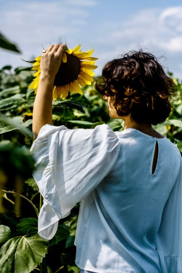 Sunflower and Woman in Garden